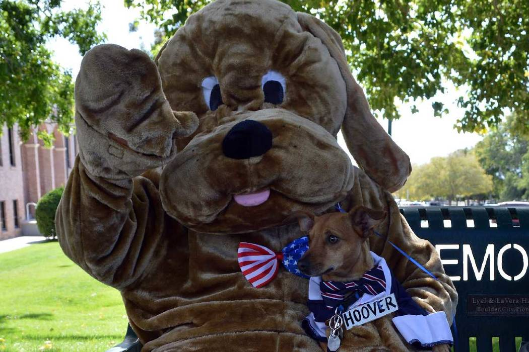 (Celia Shortt Goodyear/Boulder City Review) Councilman Warren Harhay dressed as Herbert for the inaugural Pooch Parade at Bicentennial Park on Saturday, Nov. 3, with his dog, Hoover. Presented by ...