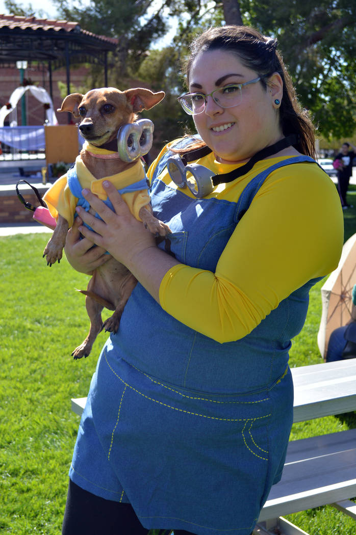 (Celia Shortt Goodyear/Boulder City Review) Jessica Abolnik and her dog, Winnie, dressed up as minions for the owner/duo category at the Pooch Parade on Saturday, Nov. 3, at Bicentennial Park.