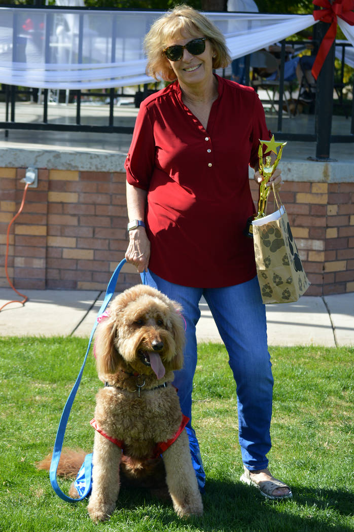 (Celia Shortt Goodyear/Boulder City Review) Sharon Newby and her dog, Ruby, won first place in the best holiday outfit category at the Pooch Parade on Saturday, Nov. 3, at Bicentennial Park.