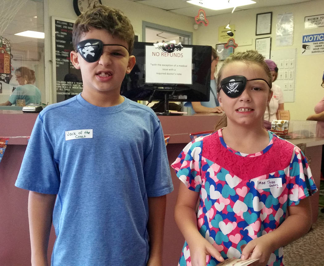 (Celia Shortt Goodyear/Boulder City Review) Joshua Edelstein and Shasta Willett practiced their pirate faces at the Pirate Party at Boulder City Pool on Saturday, Nov. 3.