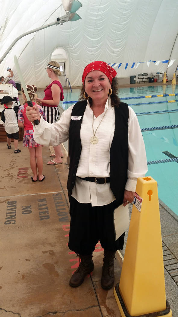 (Celia Shortt Goodyear/Boulder City Review) Boulder City's Aquatic Coordinator Cheree Brennan shows off her sword-wielding skills Saturday, Nov. 3, at the pool's pirate party.
