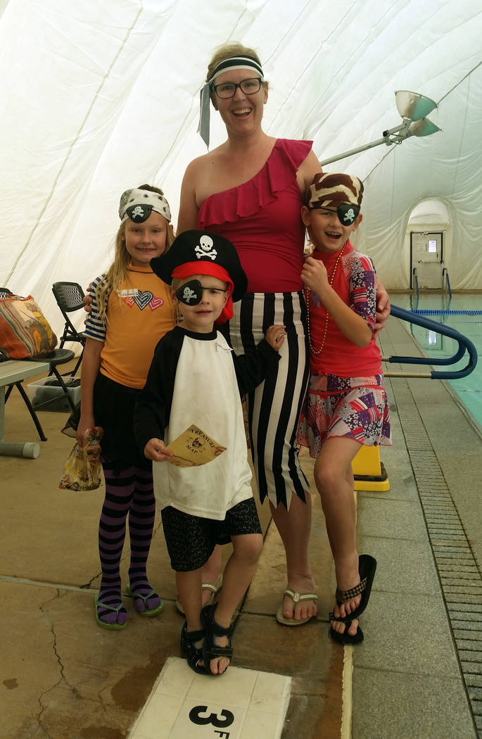 (Celia Shortt Goodyear/Boulder City Review) The Cook family, from left, Hailey, Lara, Harmony and Parker, in front, came to the pirate party at the Boulder City pool Saturday, Nov. 3, in their bes ...