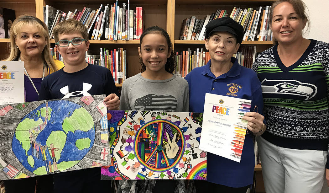 (Hali Bernstein Saylor/Boulder City Review) Winners of the Boulder City Lions Club's annual Peace Poster Contest Henry Stark, second from left, and Jocelyn Kuhn, third from left, are congratulated ...