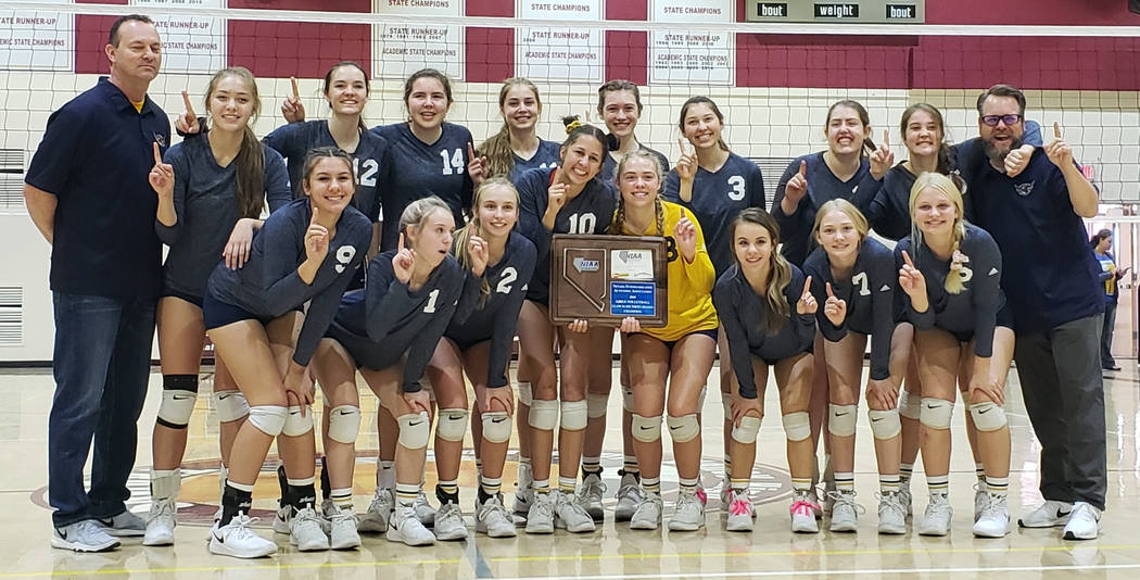 (Stephanie Wright) Members of the Lady Eagles varsity volleyball team from Boulder City High School celebrate winning the Southern Region championship Saturday, Nov. 3, 2018, at Pahrump Valley Hig ...