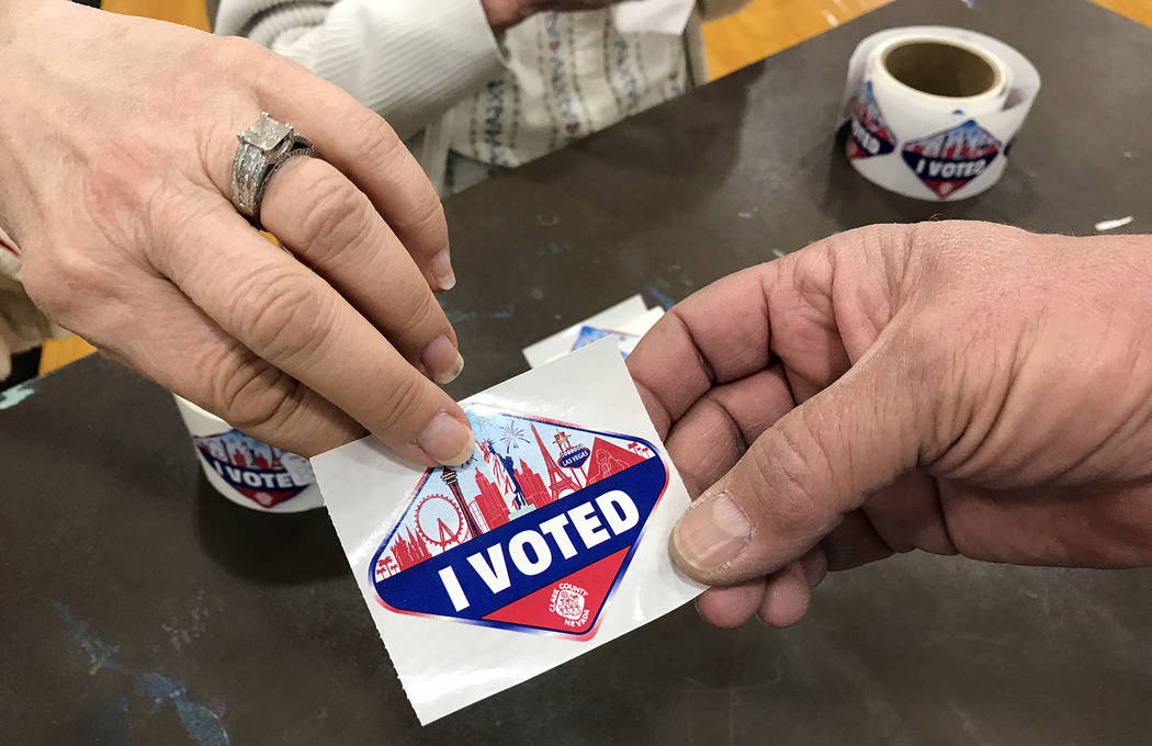 """Hali Bernstein Saylor/Boulder City Review A man receives an """"I Voted"""" sticker after casting his ballot at City Hall in Boulder City on Tuesday, Nov. 6, 2018."""