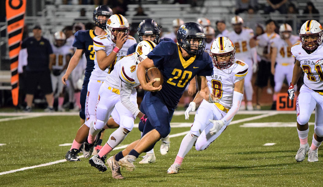 (Robert Vendettoli/Boulder City Review) Senior running back Thorsten Balmer, seen Oct. 25, 2018, breaking free for a first down against Del Sol, ended his career with Boulder City High School with ...