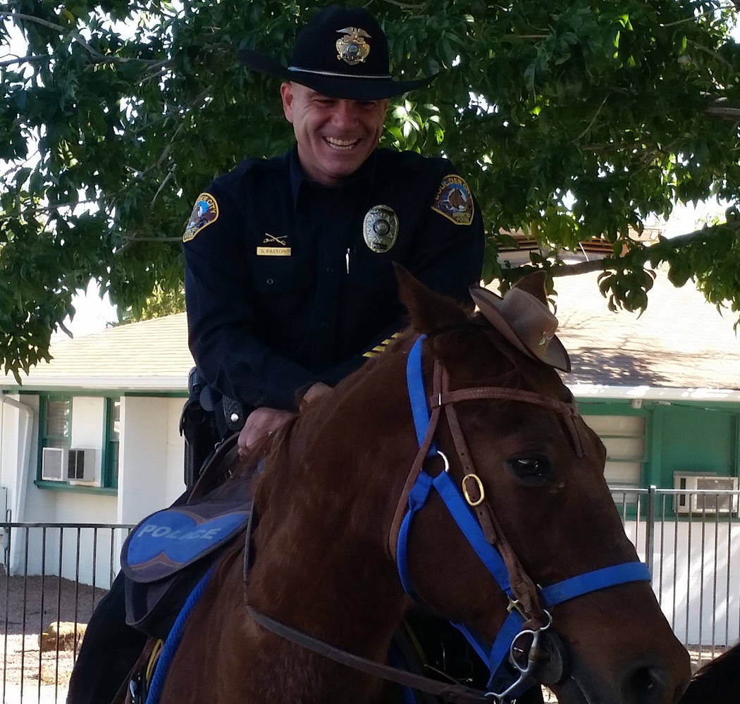 (Celia Shortt Goodyear/Boulder City Review) Boulder City Police Officer Scott Pastore chuckled at Odie's reaction to his new hat during a presentation on Wednesday, Oct. 31, to students at Grace C ...