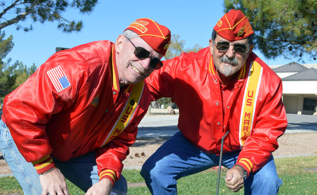 Celia Shortt Goodyear/Boulder City Review Members of the Marine Corps League of Henderson Don Ostertag, left, and Ron Dougas place United States Marine Corps flags on the graves of USMC veterans a ...