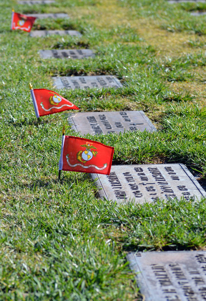 (Celia Shortt Goodyear/Boulder City Review) Volunteers and members of the Marine Corps League of Henderson placed approximately 700 United States Marine Corps flags on the graves of the military b ...