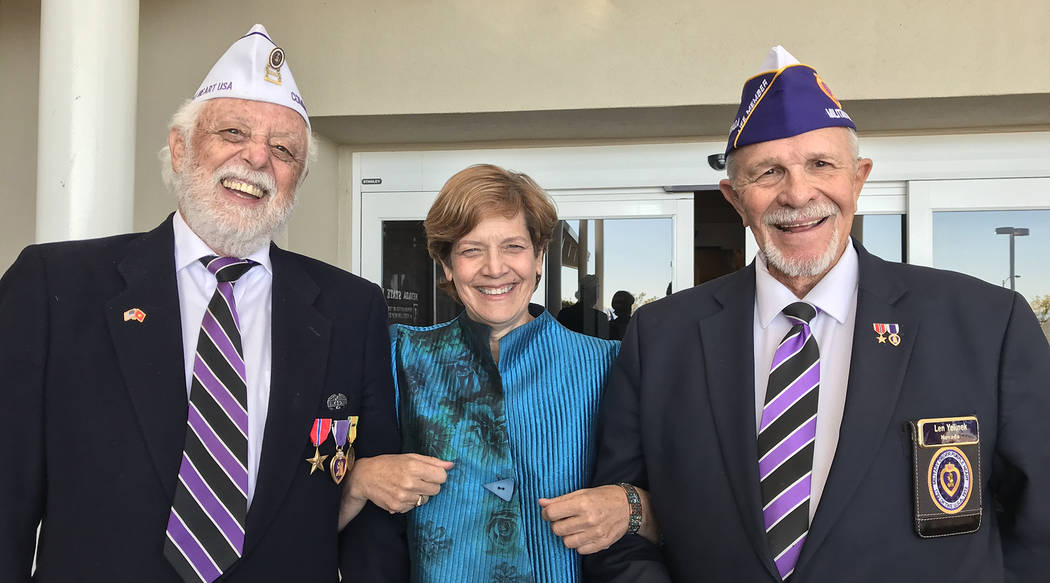 (Hali Bernstein Saylor/Boulder City Review) Richard Small, left, past commander of the Military Order of the Purple Heart, and Len Yelinek, commander, visited with Kat Miller, director of the Neva ...