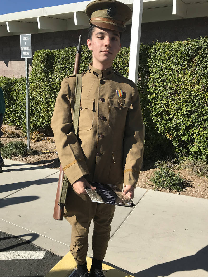 (Hali Bernstein Saylor/Boulder City Review) Dylan Signore, 15, a student at Rancho High School, dressed in a World War I military uniform as the 100th anniversary of the armistice was recalled dur ...