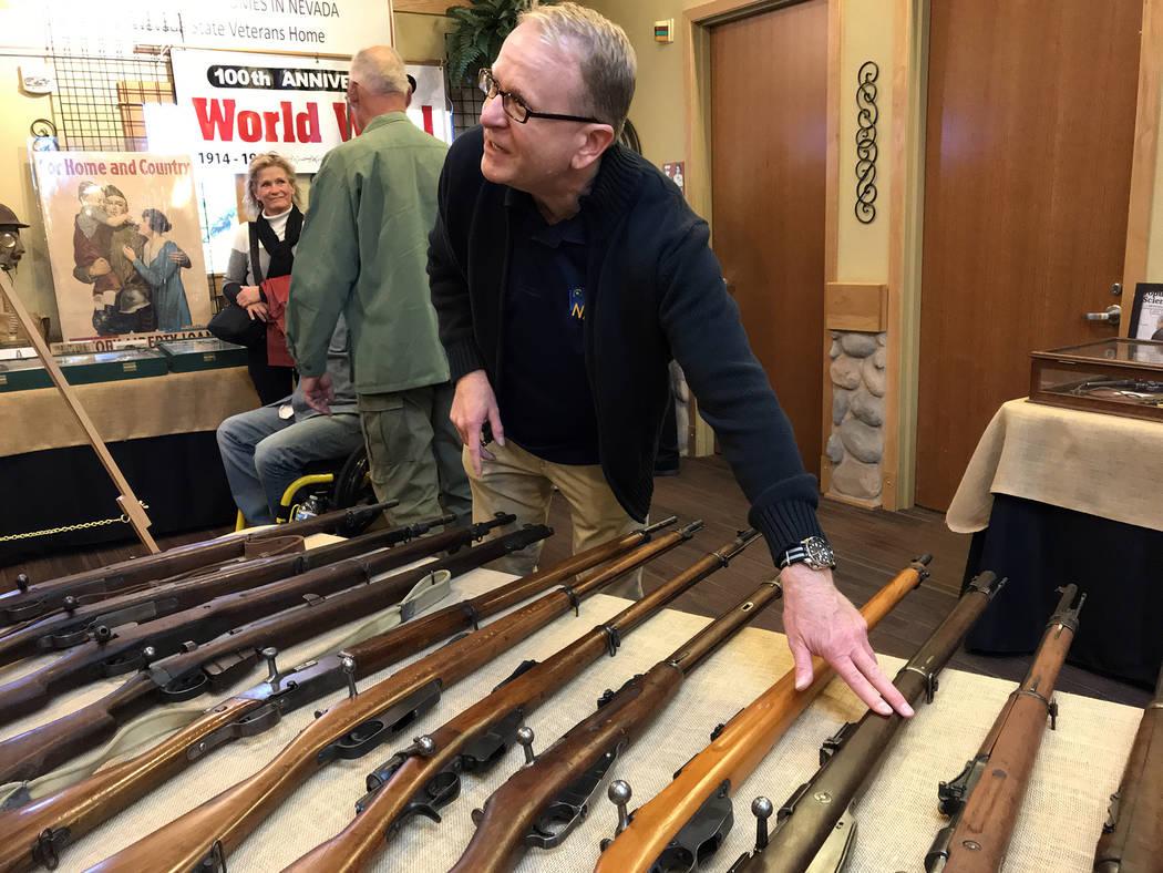 (Hali Bernstein Saylor/Boulder City Review) John Lusak showed off a collection of World War I era rifles during Veterans Day ceremonies Sunday, Nov. 11, 2018, at the Nevada State Veterans Home in ...