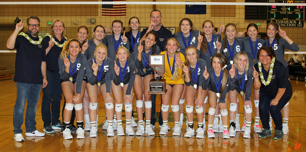 (Cheryl Herr) Members of Boulder City High School's girls varsity volleyball celebrate after winning their second consecutive state title Saturday, Nov. 10, defeating Northern Nevada challenger Tr ...