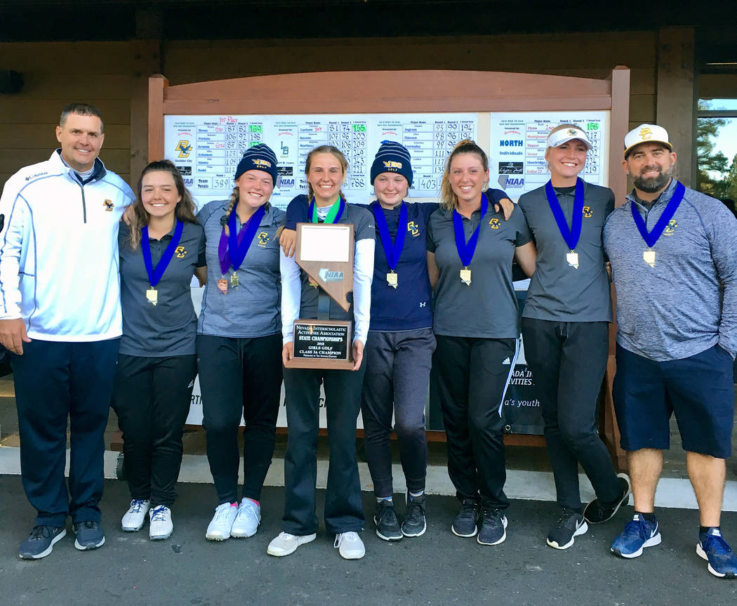 (Kelly Reese) Members of the Boulder City High School girls varsity golf team celebrate winning back-to-back state championships after an undefeated season.