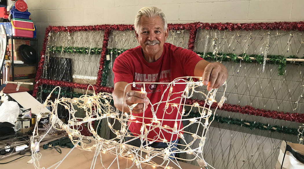 (Hali Bernstein Saylor/Boulder City Review) Dale Ryan tests the light bulbs on a sleigh that was given to him to use in the massive holiday display he creates at his home at 1525 Fifth St. This ye ...