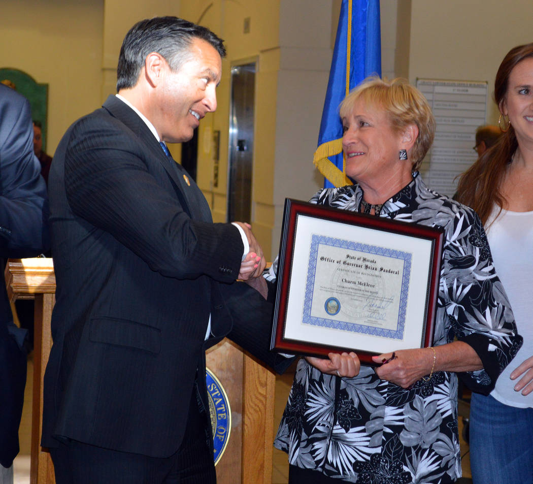 Celia Shortt Goodyear/Boulder City Review Nevada Gov. Brian Sandoval congratulates Boulder City resident Charm McElree after naming her the Nevada Department of Veterans Services Veteran Supporter ...
