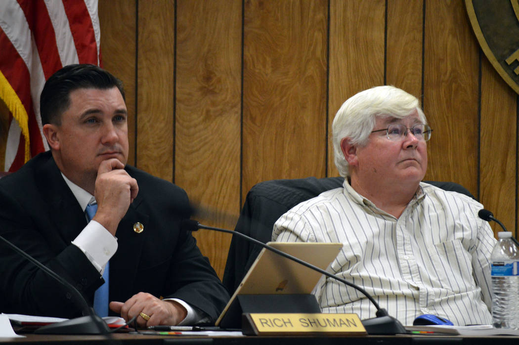 (Celia Shortt Goodyear/Boulder City Review) Councilman Rich Shuman, left, and Councilman Kiernan McManus listen to a presentation during the City Council meeting Tuesday, Nov. 27, at City Hall, wh ...