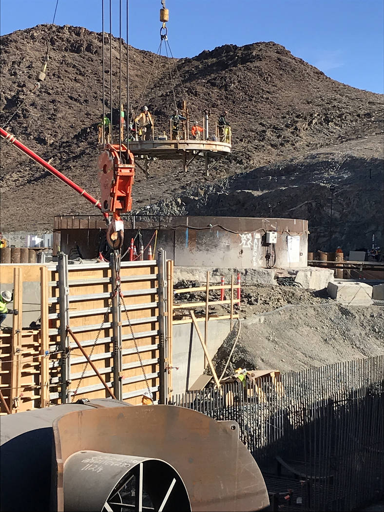 (Hali Bernstein Saylor/Boulder City Review) Crews are lowered by crane Tuesday, Nov. 27, 2018, through an access shaft to a cave 500 feet underground to work on Southern Nevada Water Authority's l ...