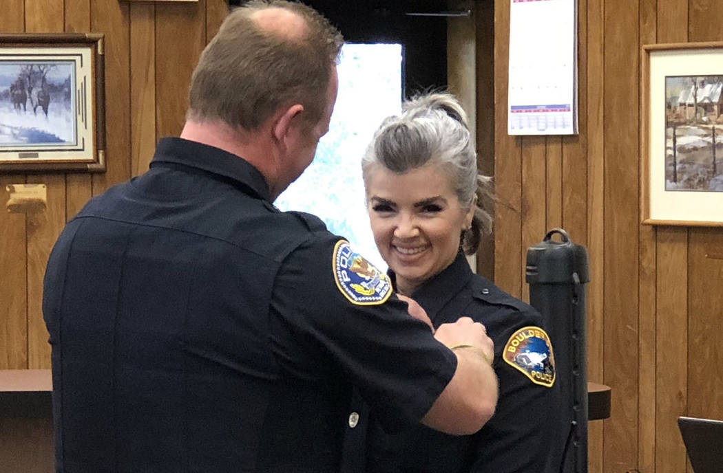 Boulder City Pamela Purkey is sworn in on Nov. 20, 2018, as the first Boulder City Police Department Marshal. Her husband, Jeremy Leinan, pinned her badge on her during the ceremony. He is a polic ...