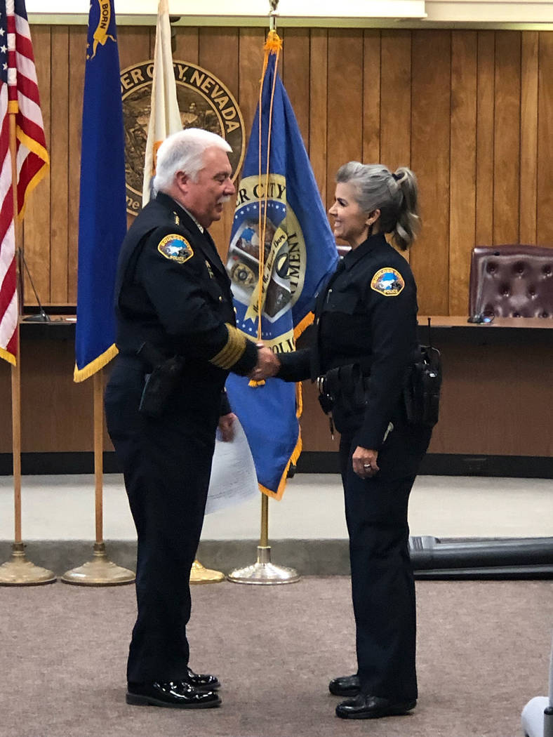 Boulder City Boulder City Police Chief Tim Shea swears in Pamela Purkey as the first Boulder City Police Department Marshal on Nov. 20.