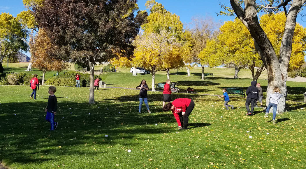 (Celia Shortt Goodyear/Boulder City Review) People had fun throwing stress balls at each other at the Community Snowball Fight at Wilbur Square Park on Saturday, Dec. 1. The event was a fundraiser ...