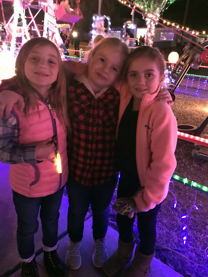 (Hali Bernstein Saylor/Boulder City Review) Friends, from left, Aviva Hnat, Mackenzie Brodowski and Lilliana Wrzalinski, were enjoying the festivities as the lights were turned on for the first ti ...
