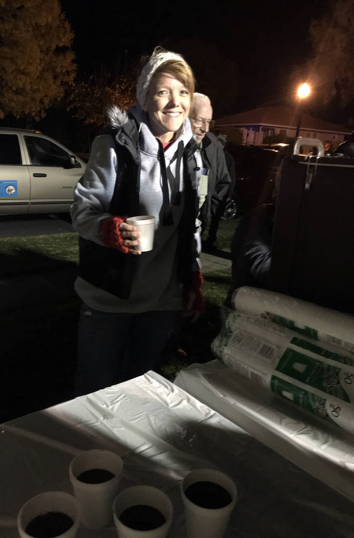 (Hali Bernstein Saylor/Boulder City Review) Kelly Flowers of the Rotary Club of Boulder City served hot chocolate to those who came to watch the city's Christmas tree lighting Friday, Nov. 30, in ...