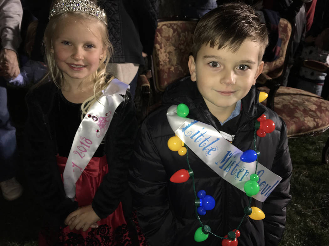 (Hali Bernstein Saylor/Boulder City Review) Little Miss Boulder City Meghan Shuman, 6, and Little Mister Boulder City Flynn Reiman, 5, helped Jingle Cat light the city's official Christmas tree Fr ...