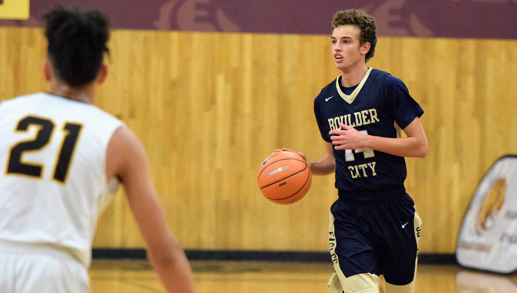 (Robert Vendettoli/Boulder City Review) Senior guard Karson Bailey of Boulder City High School brings the ball up court against Bonanza on Monday, Dec. 3, 2018. During weekend play in the Lake Mea ...