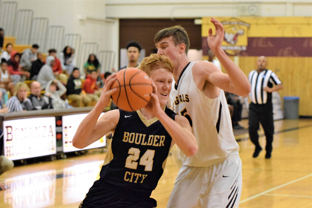 (Robert Vendettoli/Boulder City Review) Boulder City High School sophomore forward Matt Morton powers his way inside for a layup against Bonanza on Monday, Dec. 3. The Eagles won 59-57.