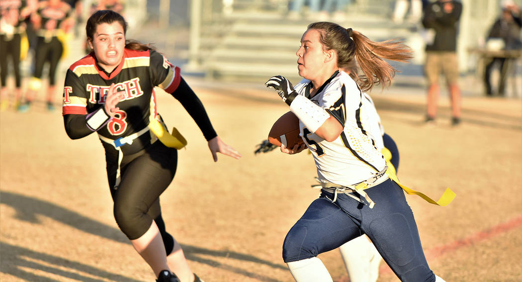 (Robert Vendettoli/Boulder City Review) Boulder City High School junior quarterback Makaela Perkins scrambles up field against Southeast Career Techical Academy on Nov. 28, 2018. She completed 17 ...