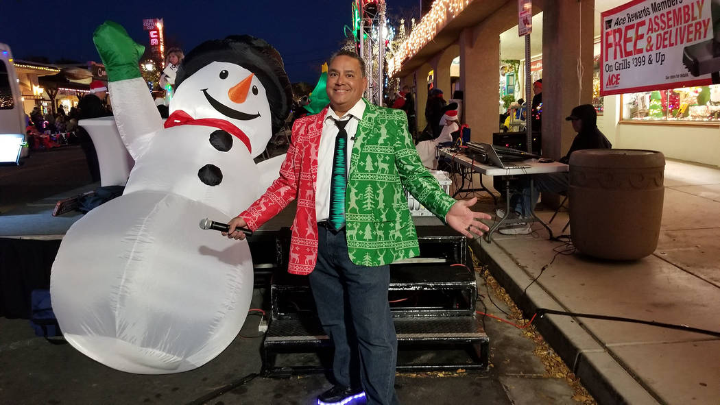 (Celia Shortt Goodyear/Boulder City Review) Mike Pacini, chairman of Santa's Electric Night Parade, showcases his Christmas tie on Saturday, Dec. 1, during the parade.