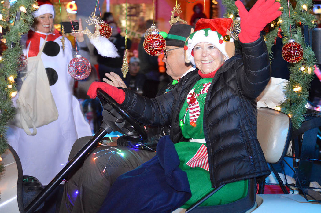 (Celia Shortt Goodyear/Boulder City Review) Boulder City Councilwoman Peggy Leavitt waives to the crowd during Santa's Electric Night Parade on Dec. 1, in downtown Boulder City.