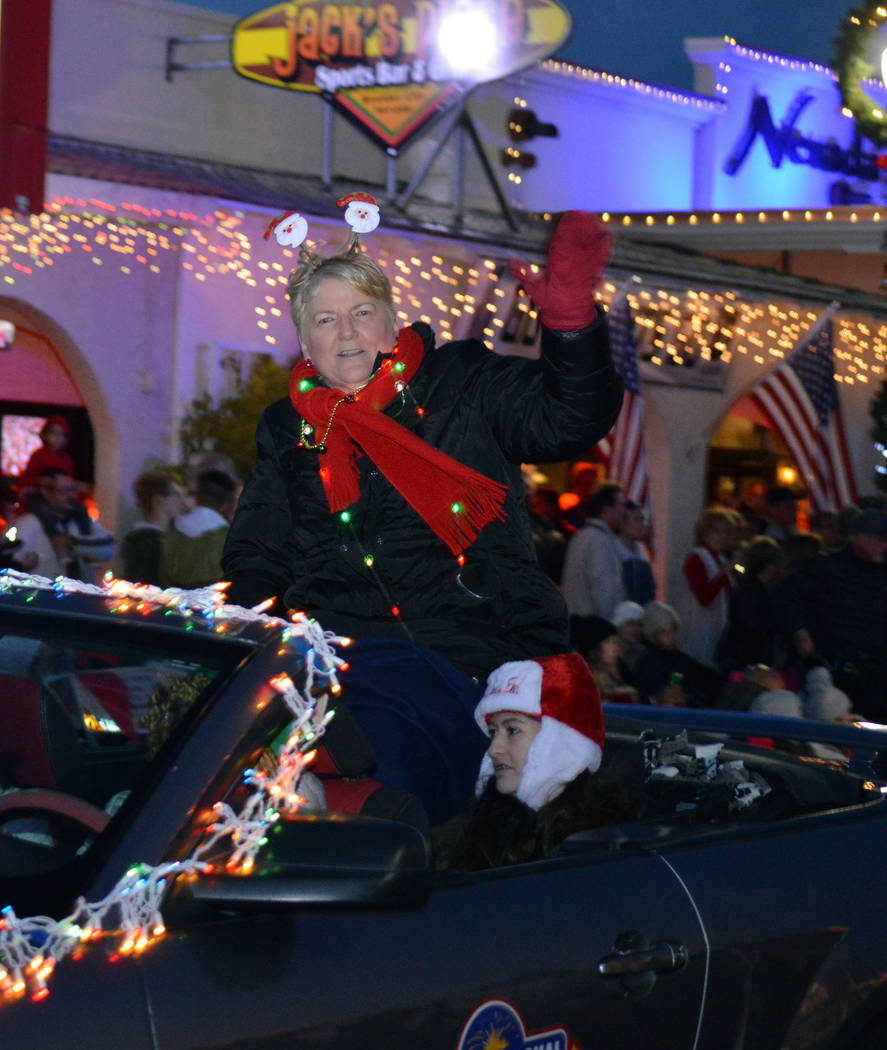 (Celia Shortt Goodyear/Boulder City Review) Jamey Hood grand marshal Santa's Electric Night Parade and principal of Garrett Junior High School, waves to the crowd during Saturday, Dec. 1.