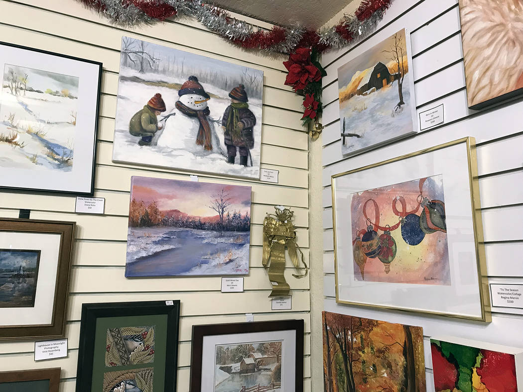 (Hali Bernstein Saylor/Boulder City Review) Members of Boulder City Art Guild have decked their walls with holiday and winter scenes for this month's showcase exhibit. The gallery is inside the Bo ...