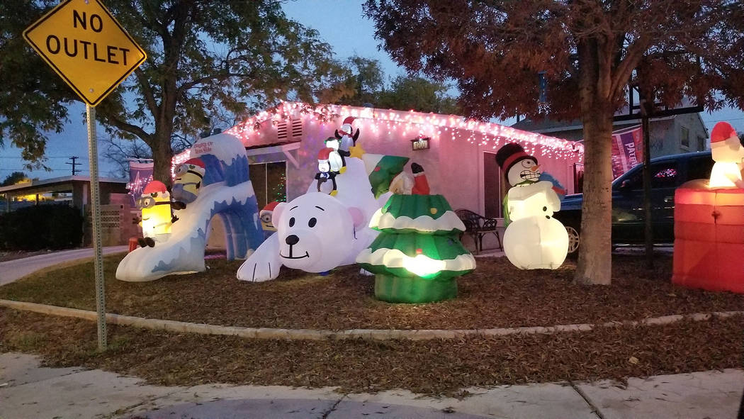 (Celia Shortt Goodyear/Boulder City Review) The Hooper-Broughear family's holiday display at 1200 Avenue I includes lights, inflatable characters and a shout out to a favorite football team. The d ...