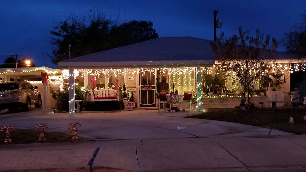 (Celia Shortt Goodyear/Boulder City Review) The house at 701 Seventh St. features a traditional Christmas display with red bow, icicle lights, candy canes and pine trees.