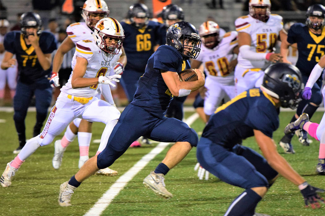 (Robert Vendettoli/Boulder City Review) Boulder City High School senior running back Thorsten Balmer dashes up field against Del Sol in the opening round of the 3A Southern Regional playoffs Oct. ...