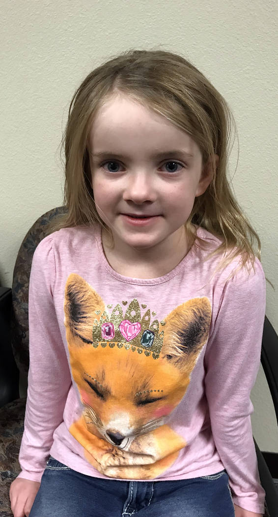 (Hali Bernstein Saylor/Boulder City Review) Mitchell Elementary School first-grader Mieke Schutlz, 6 1/2, said her favorite Christmas present was a really big stuffed dog because it was cute, fluf ...