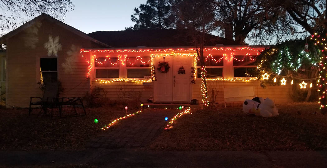 (Celia Shortt Goodyear/Boulder City Review) A house on Ash Street features Christmas lights of different color and revolving snowflakes.