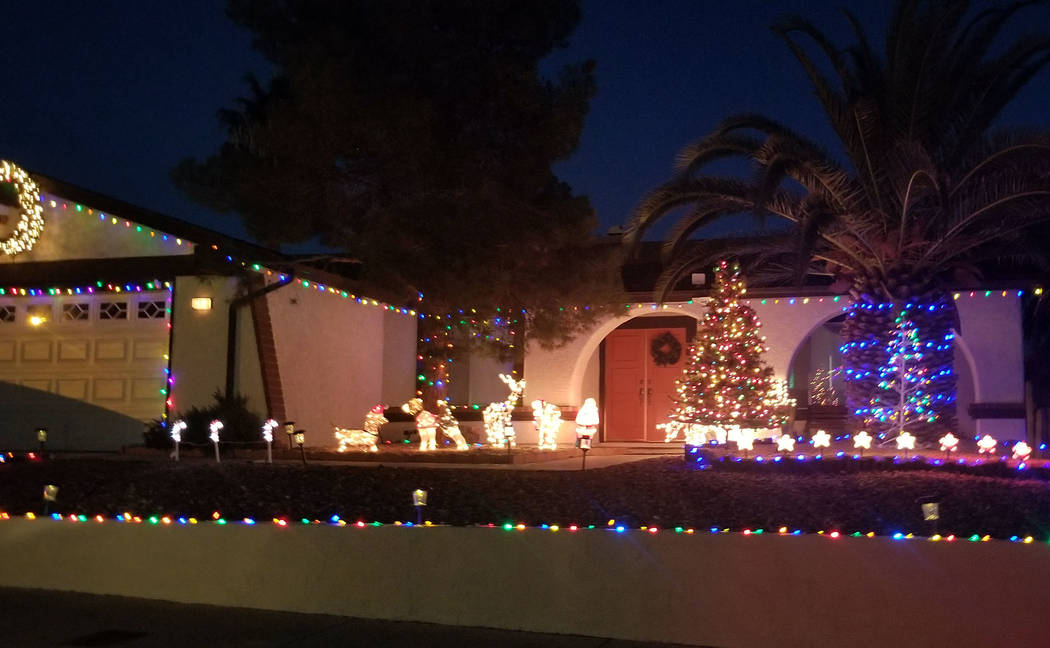 (Celia Shortt Goodyear/Boulder City Review) Houses on Darlene Way include all types of Christmas decorations including this one with a lighted Christmas tree and animals.