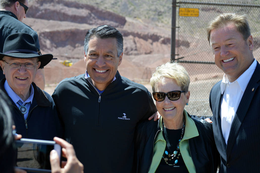 Local, state and federal officials take time to pose for a photo at The Final Spike - A Historic Reconnection on Friday, April 13, from left, Nevada Sen. Joe Hardy, Nevada Gov. Brian Sandoval, Bou ...