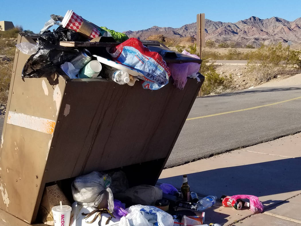 (Celia Shortt Goodyear/Boulder City Review) The trash can at the start of the Historic Railroad Trail in Lake Mead National Recreation Area is overflowing as trash service is not taking place duri ...