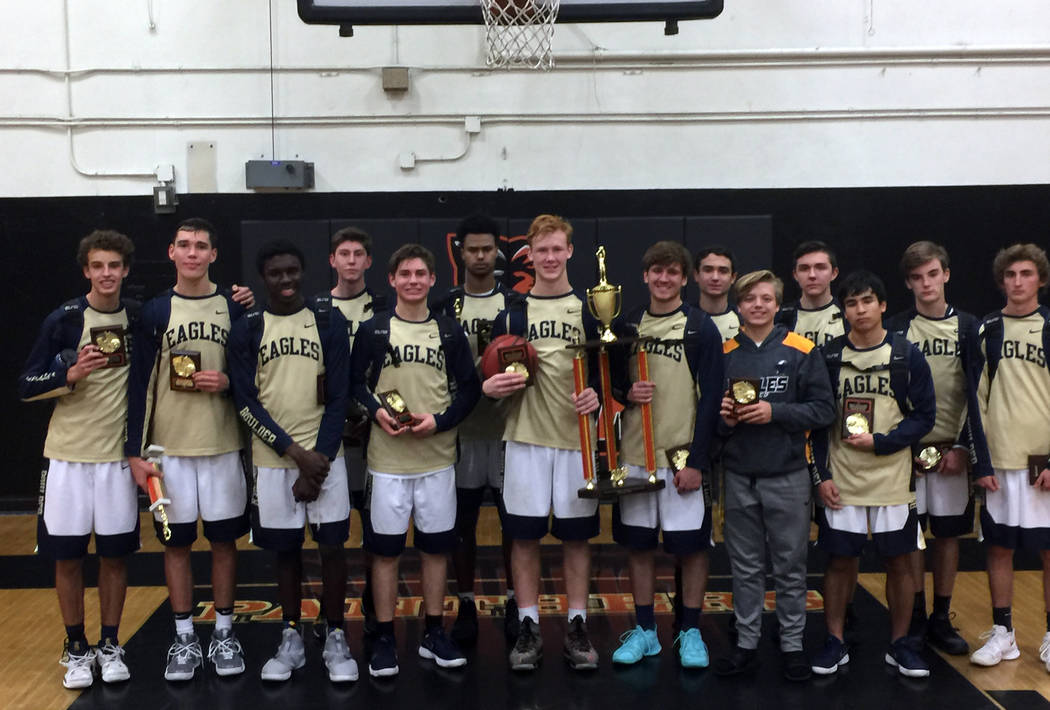 (Kurt Bailey) Members of Boulder City High School's boys varsity basketball team show off their second-place trophy and awards they won at the Orange Holiday Classic played at Orange High School i ...