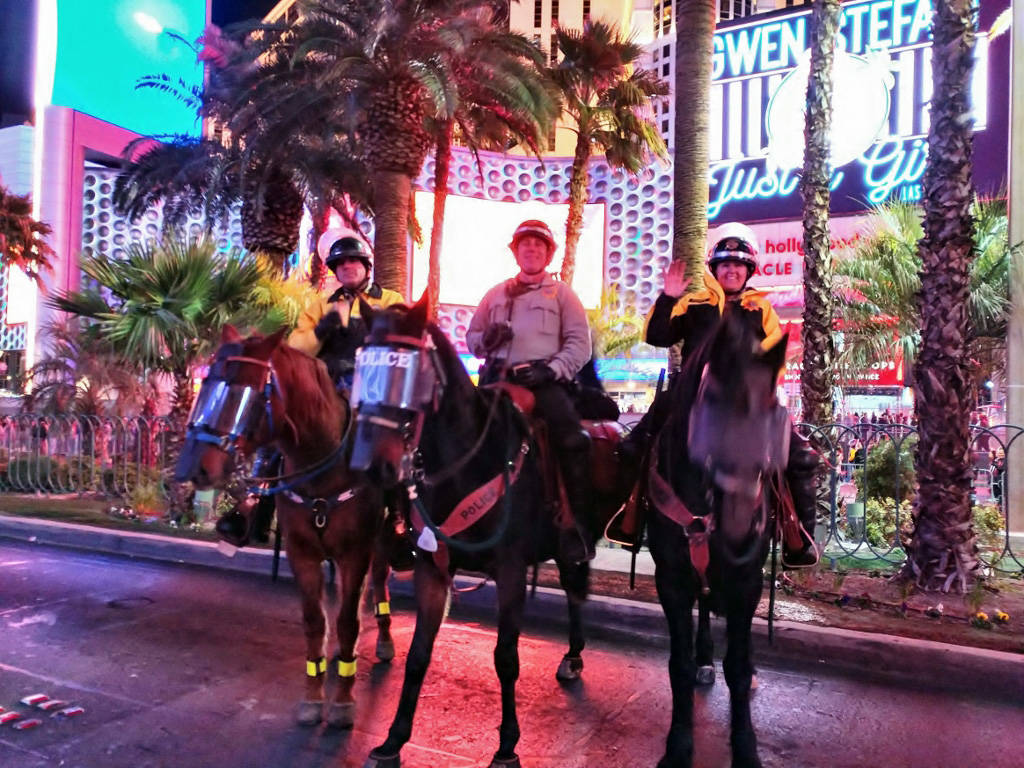 (Scott Pastore) Boulder City Police Department officer Scott Pastore, left, and his horse, Odie assist Metropolitan Police Department officers Mike Torsiello and Maile Hanks on the Strip on New Ye ...