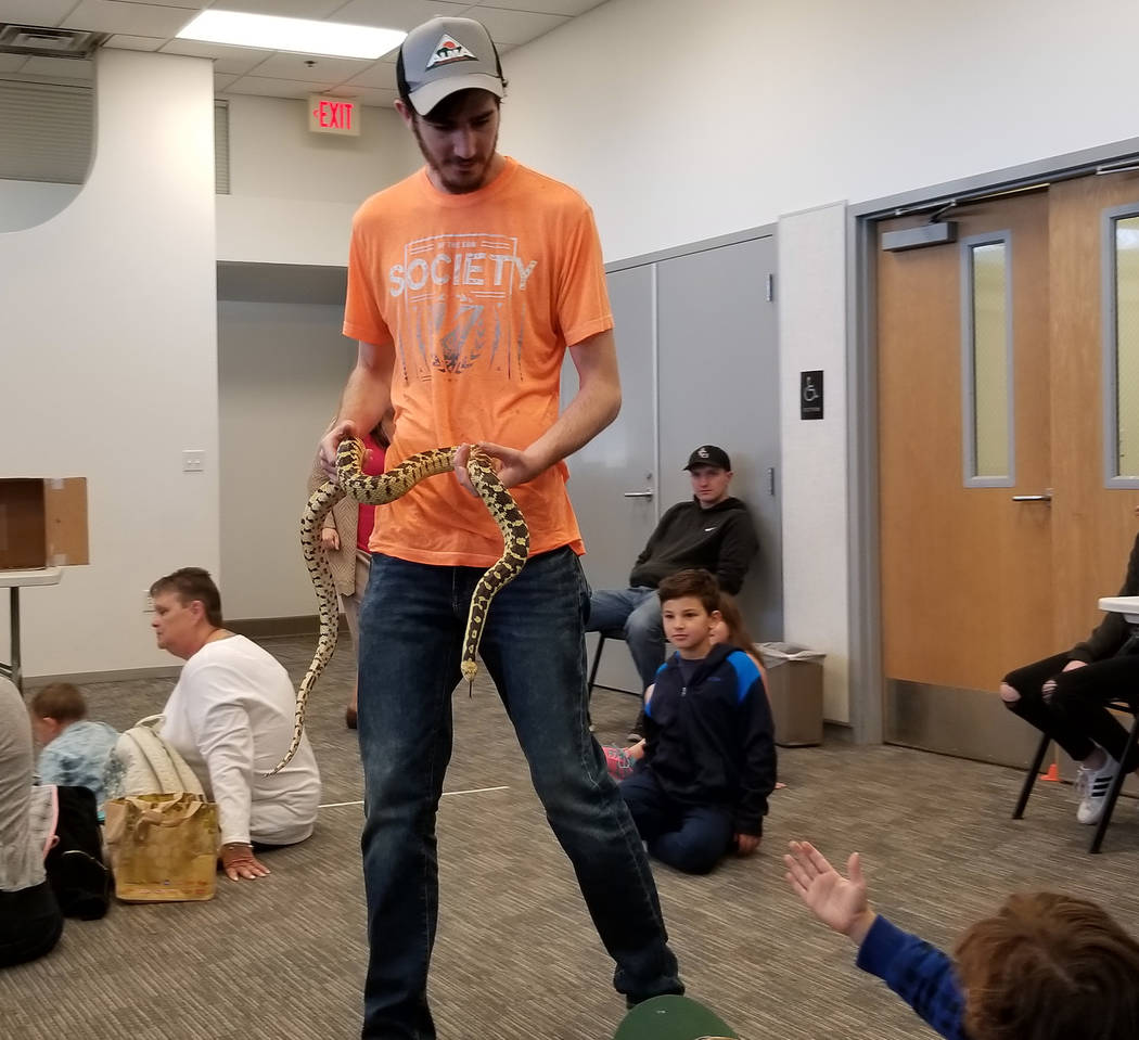 (Celia Shortt Goodyear/Boulder City Review) Garrett Meyer shows off one of his dad's gopher snakes at the Boulder City Library on Thursday, Jan. 3, as part of the winter reading program's activities.