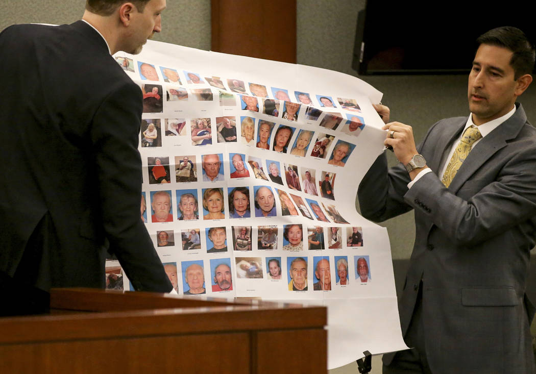 (K.M. Cannon/Las Vegas Review-Journal) Senior Deputy Attorney General Daniel Westmeyer, left, and Chief Deputy District Attorney J.P. Raman set up a display showcasing victims before the sentencin ...