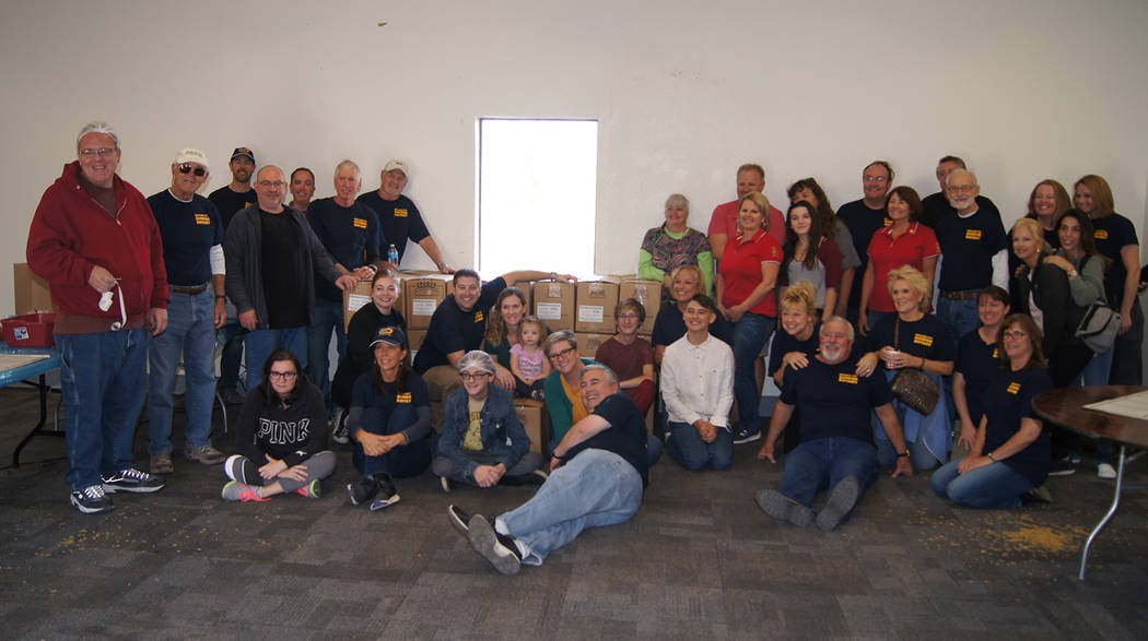 (Roger Hall) Boulder City Sunrise Rotary club members, in conjunction with the Outreach Program and Christian Center Church, recently created and packaged 10,000 meals in two hours. The meals were ...