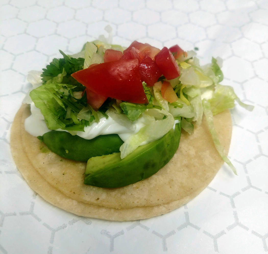 Rolando Medrano BC Dam Tacos offers an avocado taco on its menu that is vegan and vegetarian friendly. It is served on corn tortillas and toped with lettuce and tomato.