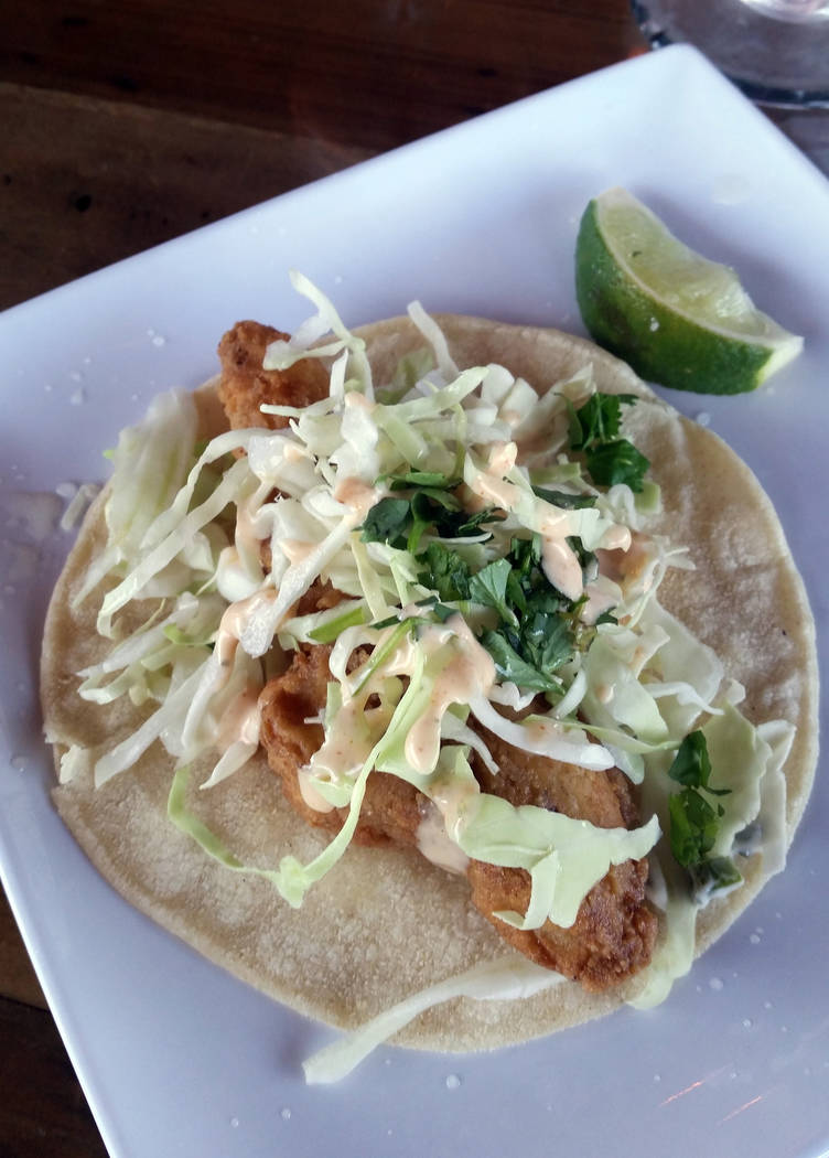 Celia Shortt Goodyear/Boulder City Review Taco Tuesday at The Tap, 704 Nevada Way, includes $3 street tacos, including fried breaded pollock that is topped with shredded cabbage, cilantro, Tapatio ...